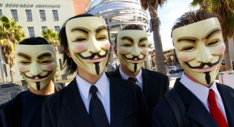 members of Anonymous in their iconic Guy Fawkes masks